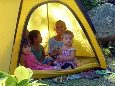 children are having fun in a tent